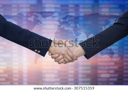 business women handshake over map on blurred business board, business hands concept. - stock photo