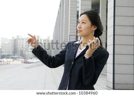 business women holding a mobile phone