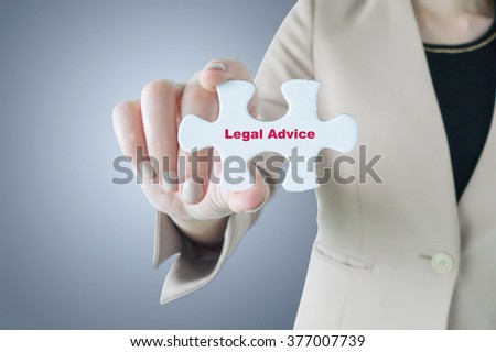 Business women holding a piece of jigsaw puzzle with word Legal Advice