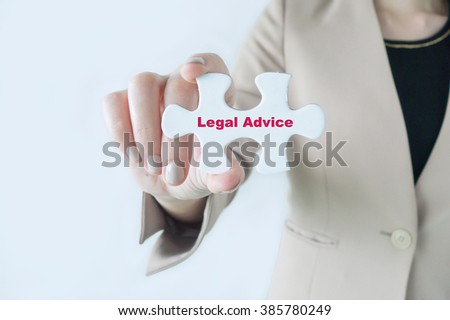 Business women holding a piece of jigsaw puzzle with word Legal Advice - stock photo