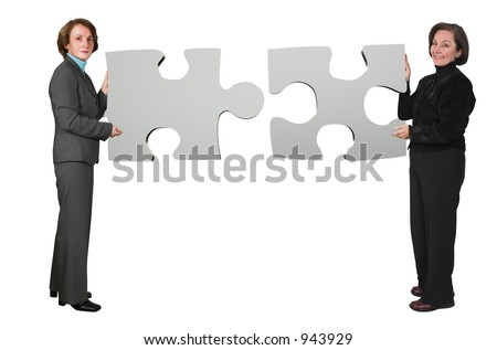 business women holding puzzle pieces