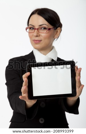 Business women holding tablet computer - stock photo
