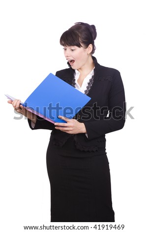 Business women looks up from finances account with an anguished expression on her face. A pretty brunette businesswoman is shocked by the finances report. Isolated over white background.