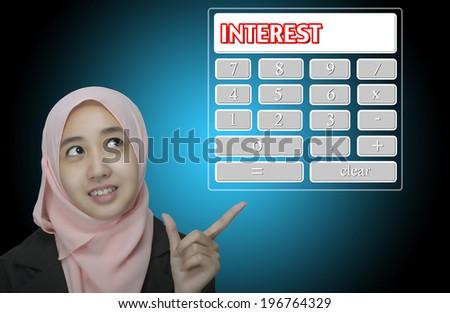 "Business Women pointing virtual calculator interface written ""interest"" - stock photo"