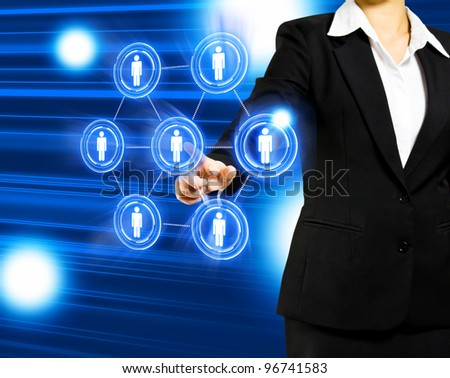 Business women pressing Social network icon - stock photo