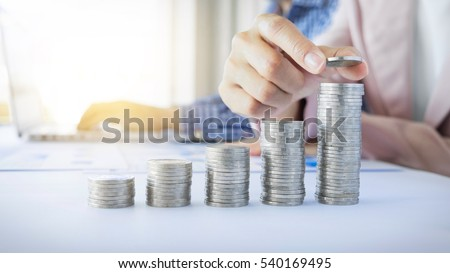 Business women put coin stack money for money growth concept, save money for the future