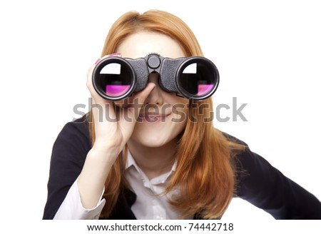Business women seeking with binocular. Studio shot. - stock photo