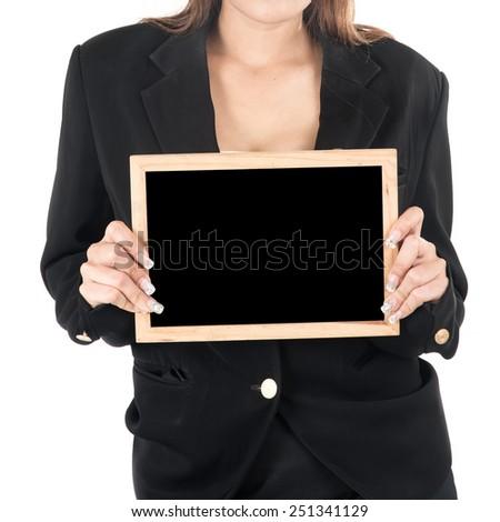 Business women show empty blackboard - stock photo