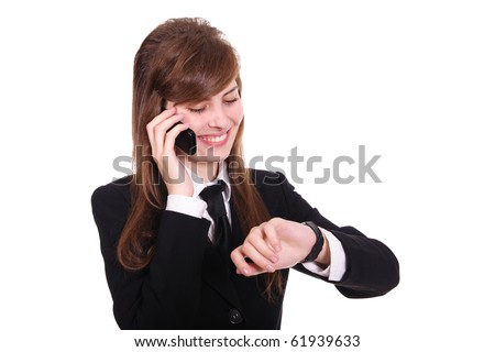 business women speaks by phone and looks at the wrist watch - stock photo