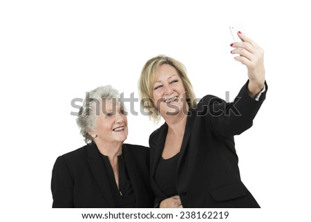 Business women taking a photo of themselves against a white background - stock photo