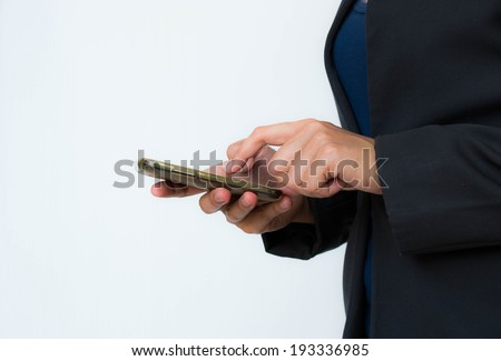 Business women touching telephone