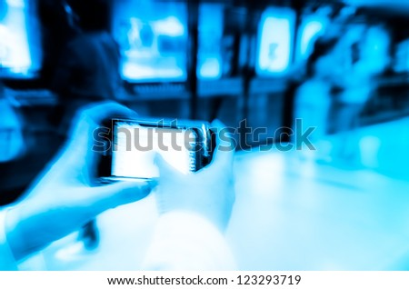 business women using cell phone on subway station blur motion - stock photo