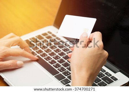 Business women using computer purchase online or banking online in her home. Vintage filter - stock photo