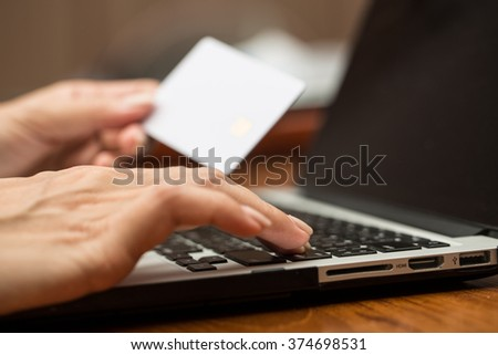 Business women using computer purchase or banking online in her home. - stock photo