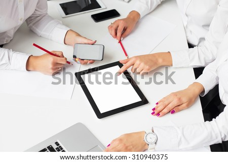 Business women using tablet computer at the meeting - stock photo