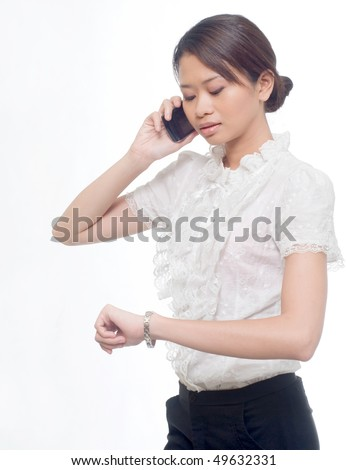 business women with handphone and looking at watch - stock photo