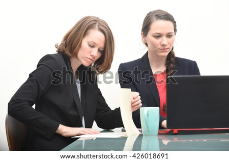 Business women working together in conference room to solve a problem - stock photo
