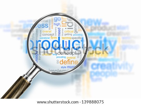 Business words collage under a magnifying glass - stock photo