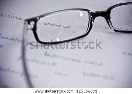 business words with glasses focusing on business view