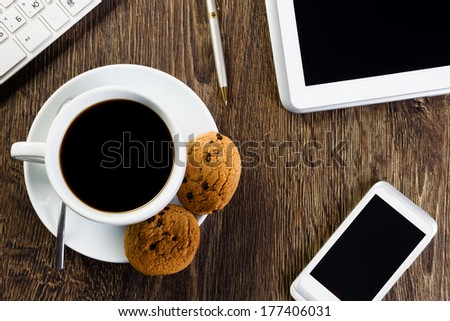 Business work place with cup of coffee calculator and glasses - stock photo