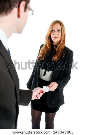 Business workers exchanging business cards - stock photo