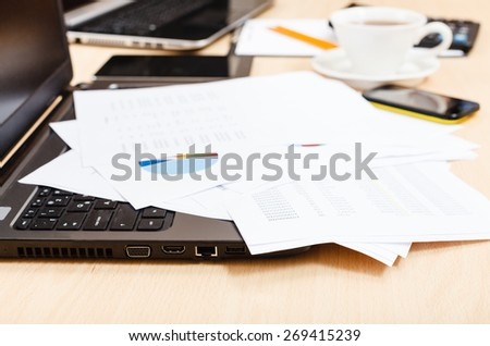 business workflow - diagrams and modern office tools on desk - stock photo