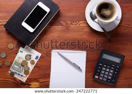 Business workplace with money and office supplies, top view - stock photo