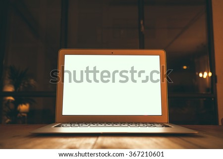 Business workspace with open laptop on vintage wooden desk.blank screen for your design,text or content  - stock photo