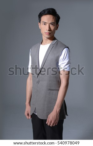 Business young man isolated-gray background