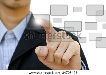 business young pushing digital button on whiteboard. - stock photo