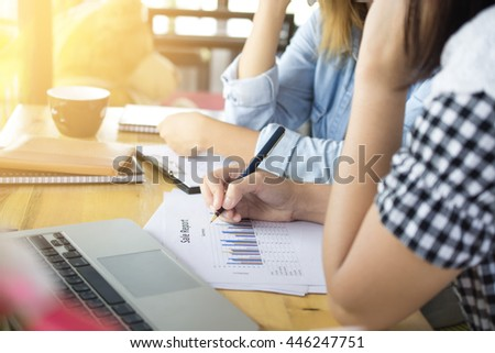 business young woman's hands with pen writing on notebook - stock photo