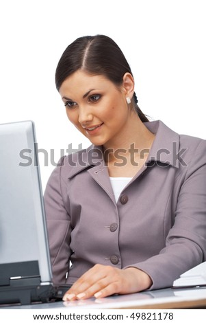 Business young woman sitting at her desk looking surprised on her laptop - stock photo