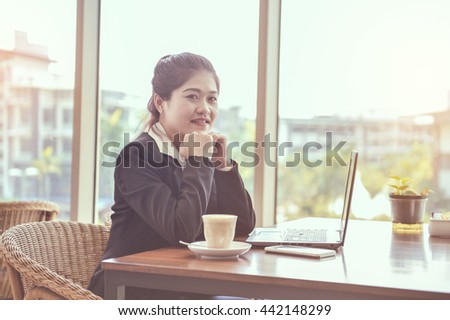 Business young women smile in cafe. Image is Instagram filtered  - stock photo