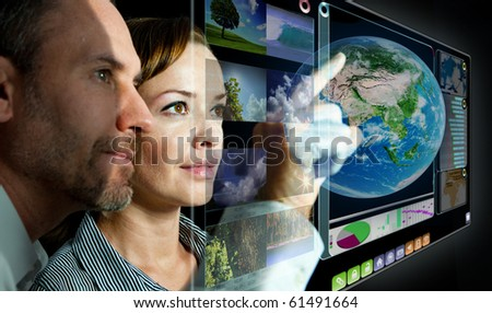 businesscouple are working with 3D display - stock photo