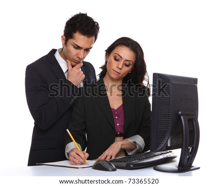 Businesscouple problemsolving near a desktop computer - stock photo