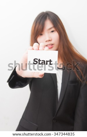 Businessgirl holding contact card with Start message