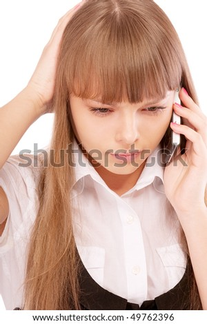 Businessgirl is dissatisfied with phone conversation, isolated on white background. - stock photo