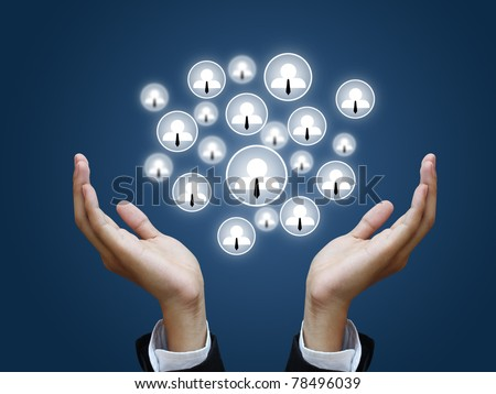 Businesshand holding social network - stock photo