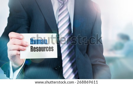 Businessman a card with Human Resources written on it. Instagram styling applied. - stock photo