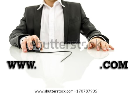 Businessman accessing a web address with the text www - blank copyspace - dot com - in the foreground with the mans hand holding a computer mouse wired to the text in the background - stock photo