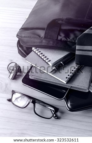 Businessman accessories and notebook bag on desk, Business concept, Monochrome tone