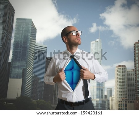 Businessman acting like a superhero with blue torso - stock photo