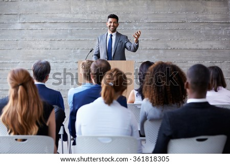 Businessman Addressing Delegates At Conference - stock photo