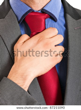 Businessman adjusting his collar isolated on white - stock photo