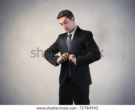 Businessman adjusting his jacket - stock photo