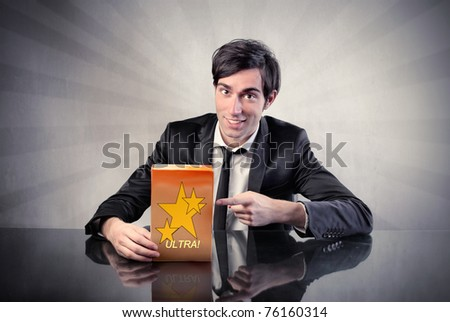 Businessman advertising a product - stock photo