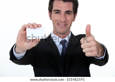Businessman advertising his company via business card