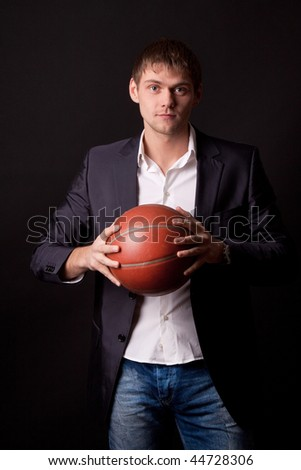 businessman after hard work day whant to play basketball - stock photo