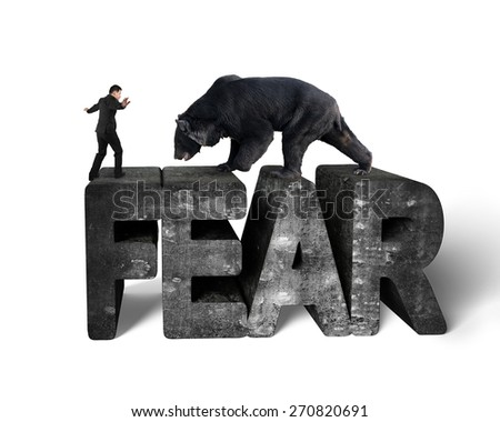 Businessman against black bear balancing on 3d fear mottled concrete word with white background - stock photo