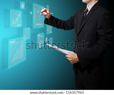 businessman analysis graph on screen high technology - stock photo